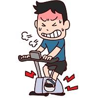 苦しそうにエアロバイクを漕ぐ男性