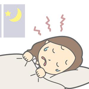 夜、うなされている女性
